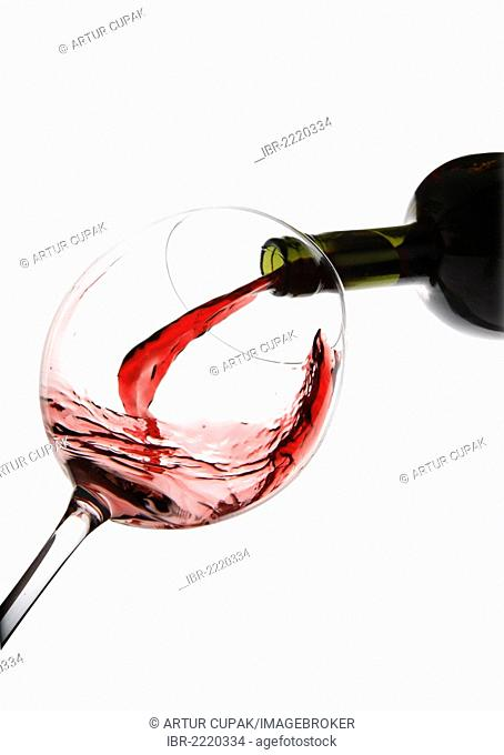 Red wine being poured into a red wine glass