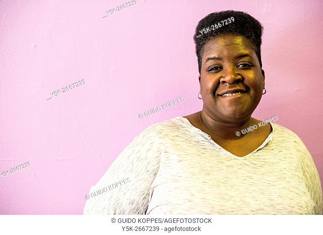 Newark, New Jersey, USA. portrait of an African-American lesbian and married woman, working as a volunteer for the local LGBTQ Community Center