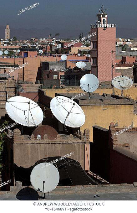 Mosque minarets and satellite television dishes Marrakech skyline Morocco