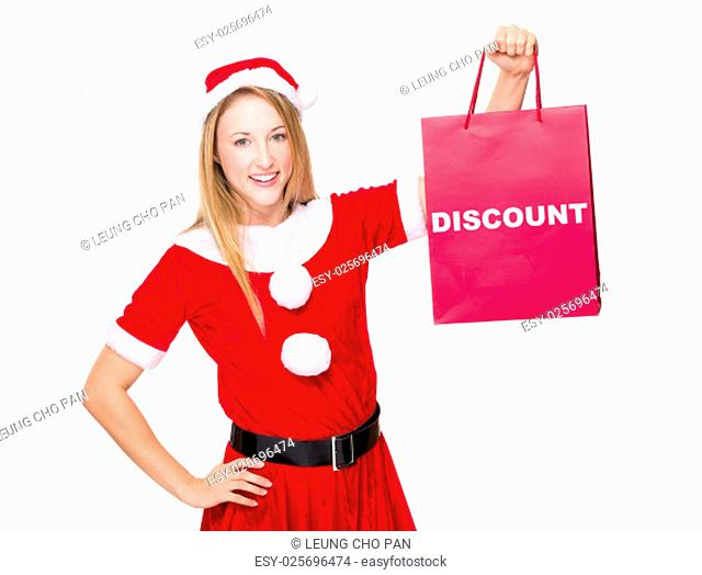 Christmas party dressing girl with shopping bag showing a word discount