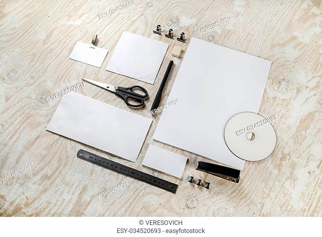 Photo of stationery set on light wooden background. Blank template for design presentations and portfolios