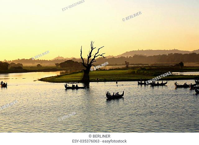 sunset boat trip on the Taungthaman Lake in Amarapura, Myanmar