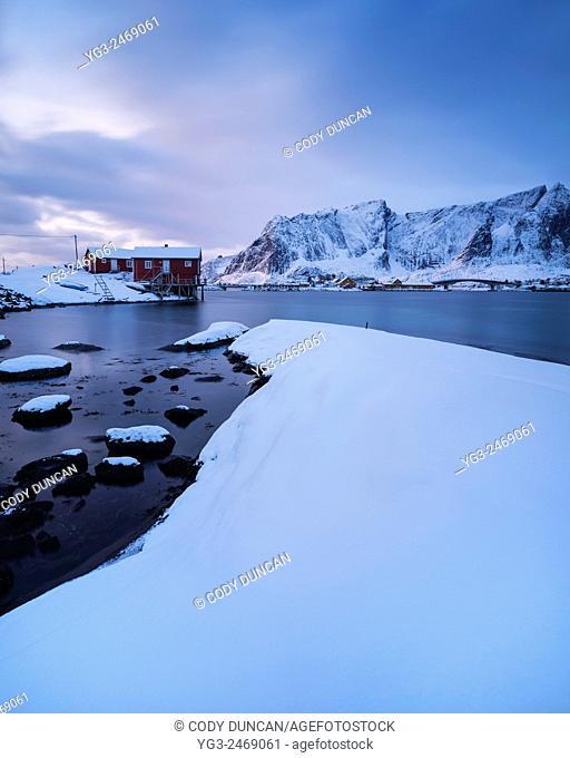 Traditional red seaside Rorbu cabins in winter, Toppøy, Reine Moskenesøy, Lofoten Islands, Norway