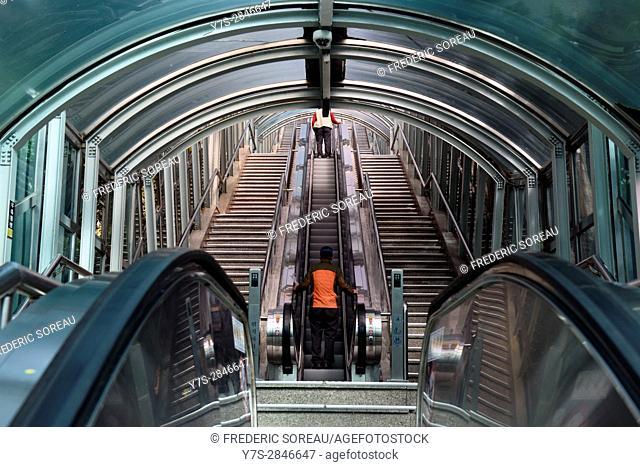 People going up escalator,Seoul,South Korea