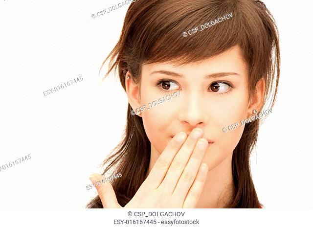 teenage girl with palms over mouth