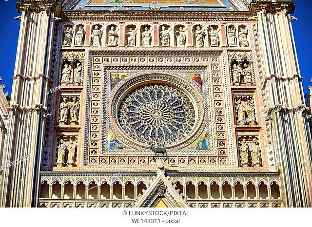 Close up of the rose window built by the sculptor and architect Orcagna between 1354 and 1380 on the14th century Tuscan Gothic style facade of the Cathedral of...
