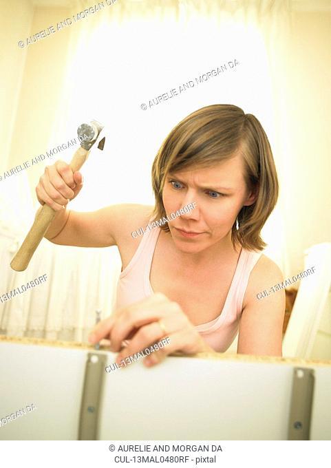 Woman building furniture