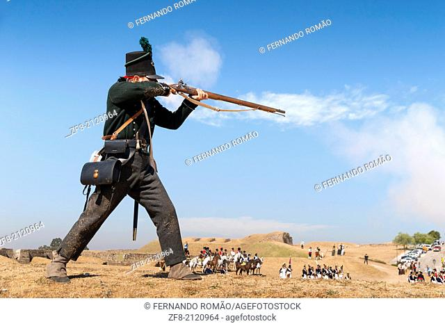 Firing a riffle at a Napoleonic battle reconstitution, Almeida, Portugal