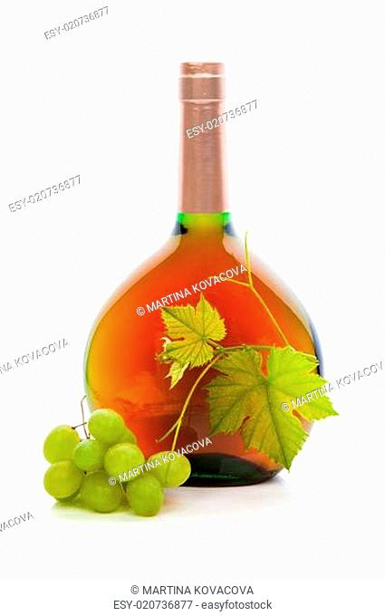 Wine bottle with wine grapes and grape leaves