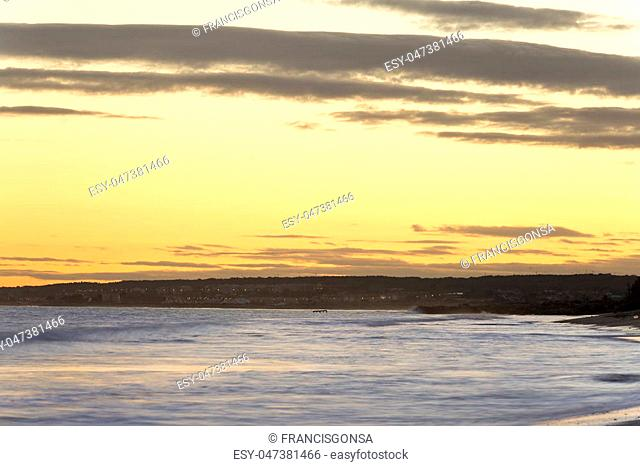 Sunset on the beach of La Gola in Santa Pola, province of Alicante in Spain