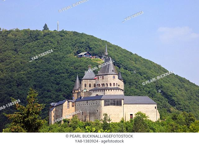 Vianden, Grand Duchy of Luxembourg, Europe  View of the hilltop castle with chairlift on the wooded hill beyond