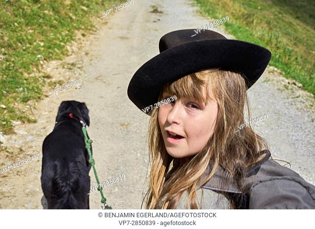 young girl with dog during hiking adventure
