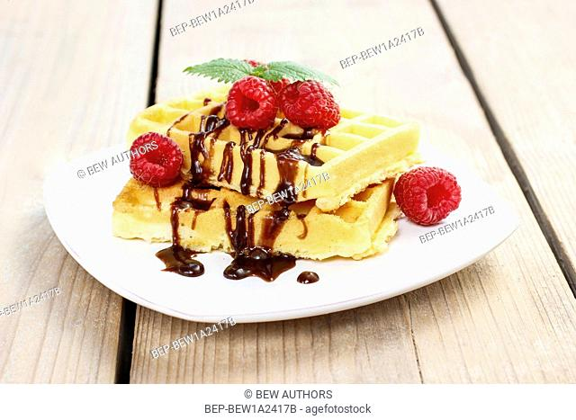 Waffles with chocolate and raspberries. Party dessert