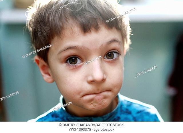 Portrait of a cute little boy grimasing