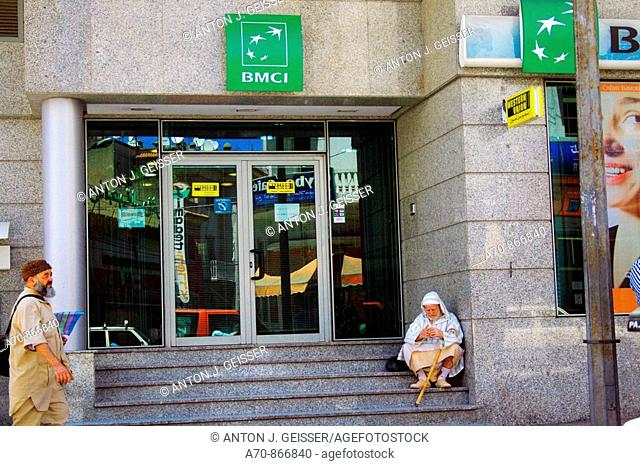 Man before BMCI bank in Tanger (Morocco)