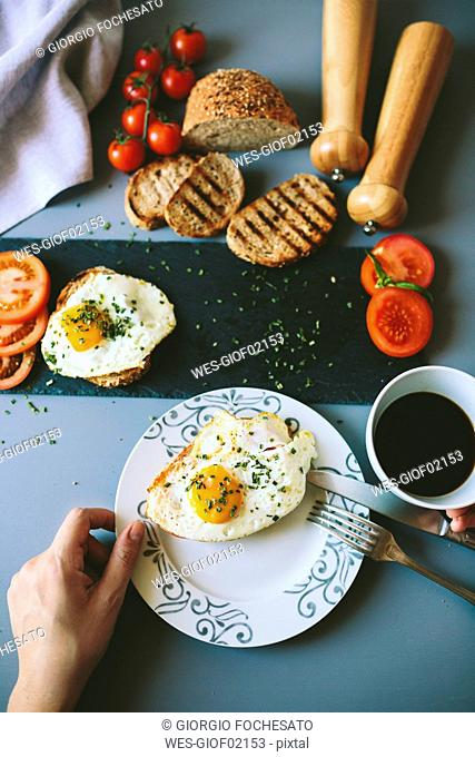 Breakfast with eggs, coffee and tomatoes