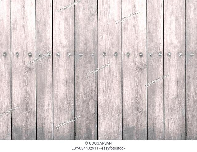 White wooden textured woodgrain background with metal screws
