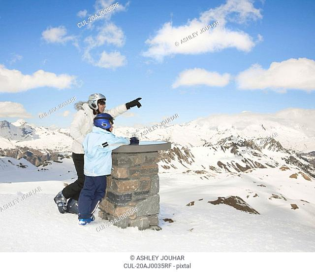 Woman with boy in snowy mountain scene