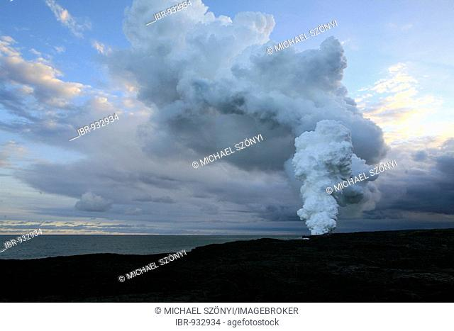 Spouts of smoke and steam from the active lava flow on the Eastern Rift, Kilauea Volcano, Big Island, Hawai'i, Hawaii, USA