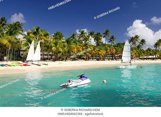 France, Guadeloupe French West Indies, Grande Terre, Sainte Anne, jet ski in the lagoon and sailboats and kayaks on the Plage de la Caravelle or beach of the...