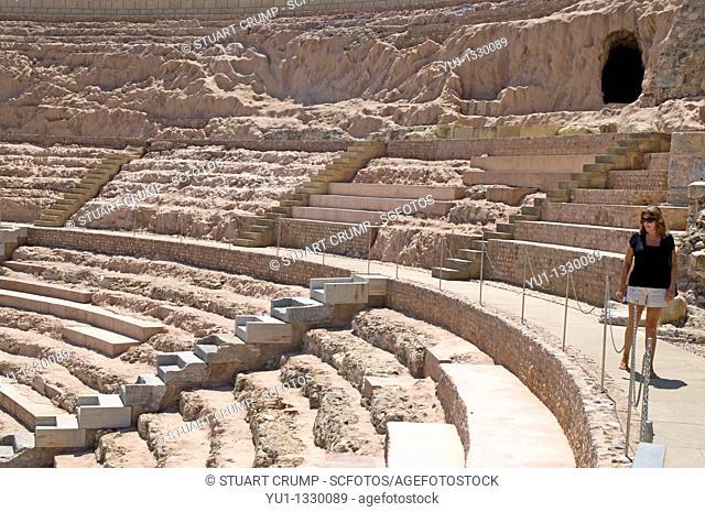 Female Tourist look's around the Roman Amphitheatre in Cartagena, Murcia, Spain