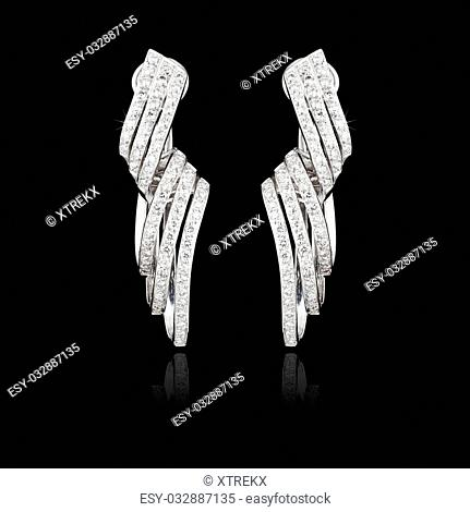Diamod earrings isolated on the black background