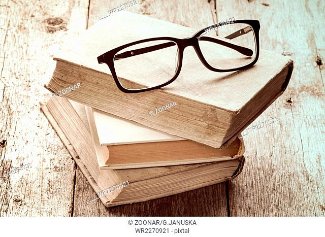 Old books and reading glasses