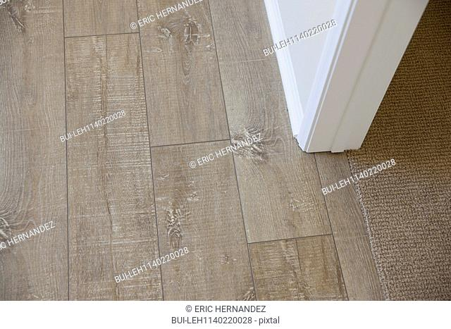 Detail shot of wooden and area rug at home