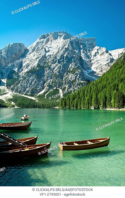 Fishing boats docked in the turquoise blue water of Lake Braies, a jewel at the foot of Croda del Becco in the Fanes- Sennes-Braies Natural Park Dolomites...