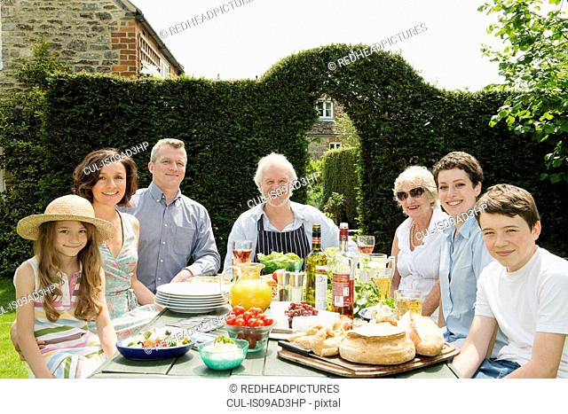 Portrait of three generational family enjoying lunch outdoors