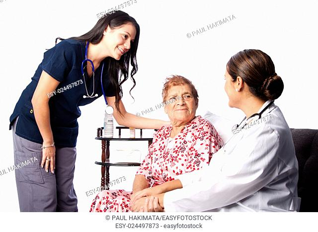 Doctor and Nurse consulting comforting Senior Patient at home health