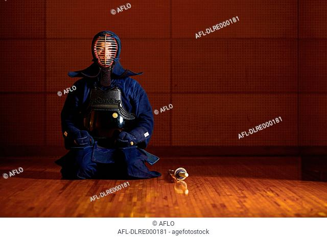 Japanese kendo athlete preparing for the fight