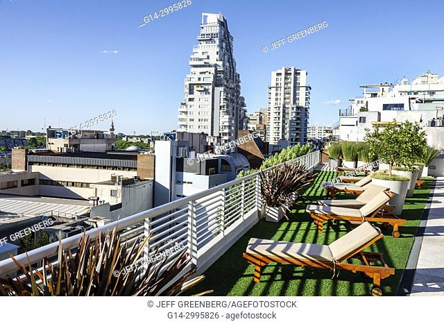 Argentina, Buenos Aires, Palermo, Dazzler Polo, hotel, rooftop terrace, city skyline, view, apartment building, architecture, lounge chair, railing, planter