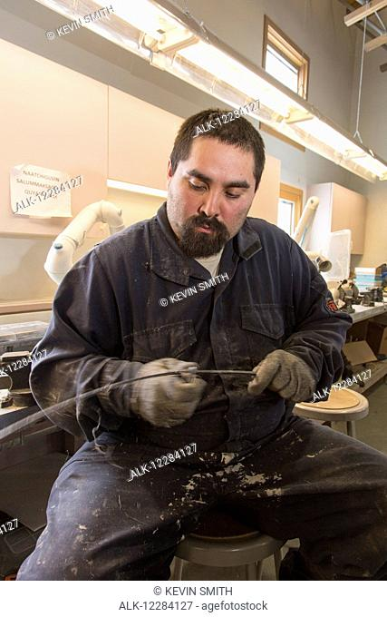 Male native artist scraping Bowhead whale baleen at the Inupiat Heritage Center, Barrow, North Slope, Arctic Alaska, USA