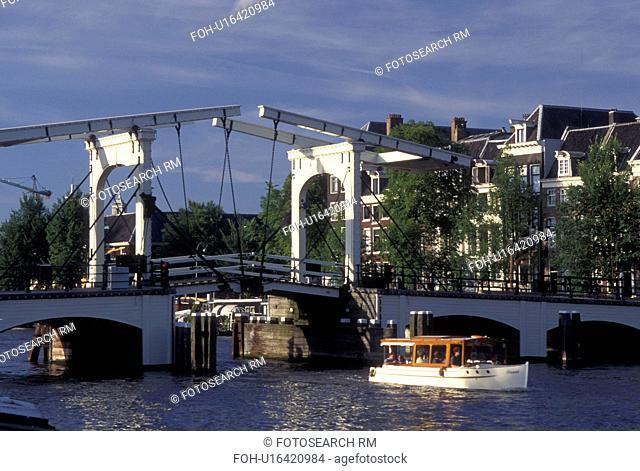 drawbridge, Amsterdam, Holland, Netherlands, Noord-Holland, Europe, Boat cruises under Skinny Drawbridge on a canal in Amsterdam