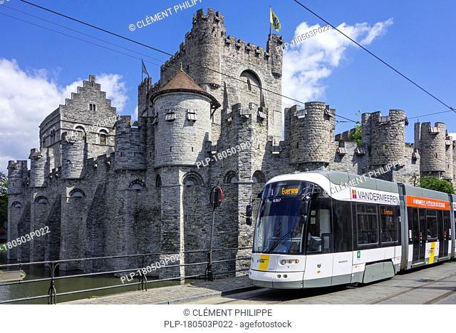 Tram of De Lijn in front of medieval Gravensteen / castle of the counts in the historic city centre of Ghent, East Flanders, Belgium