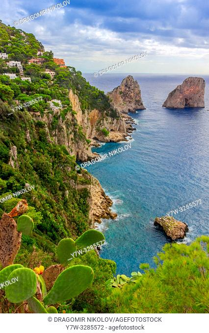 Sea view by Capri island, Italy. The rocks are famous as Faraglioni rock. Locals say that they have seen sirens on this rock and often hear their whistling