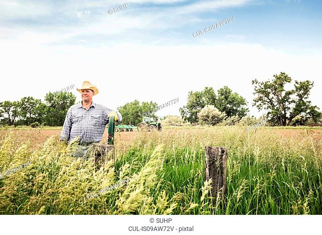 Portrait of male farmer on edge of a field