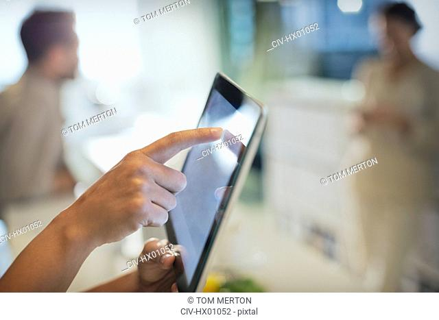 Close up businessman touching digital tablet