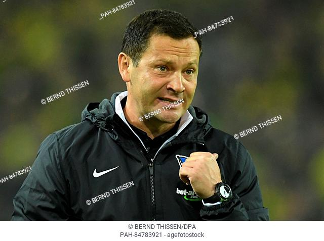 Coach of Berlin, Pal Dardai, cheers on his players during the match between Borussia Dortmund and Hertha BSC on the seventh match day of the German Bundesliga...