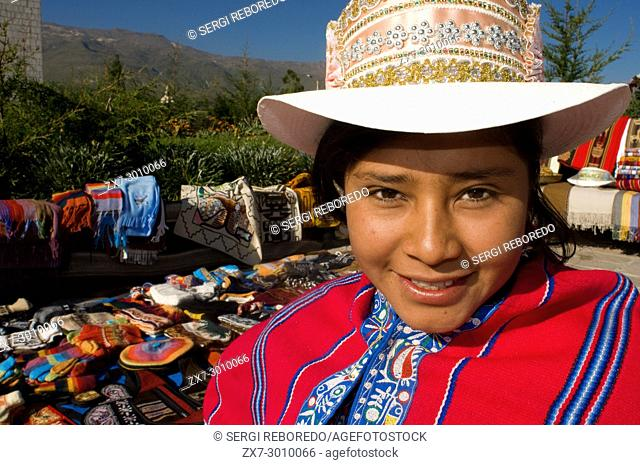 A saleswoman dressed in her typical regional costume in Yanke, one of the small towns in the Colca Valley. Colca Canyon, Arequipa, Peru