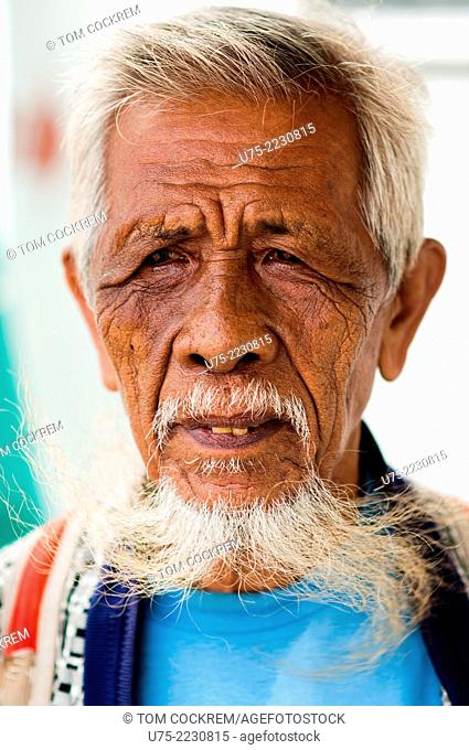 Elderly man on ferry, en route from Ozamis City, Misamis Occidental, Mindanao, Philippines