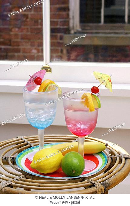Tropical drinks and fruit in loft by window