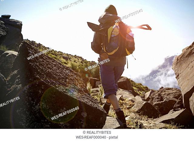 Portugal, Madeira, man on hiking trip along the Levadas