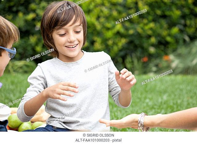 Boy playing hand slap game