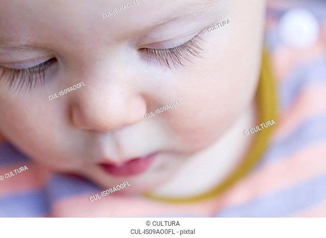Close up of the face of baby girl with long eye lashes