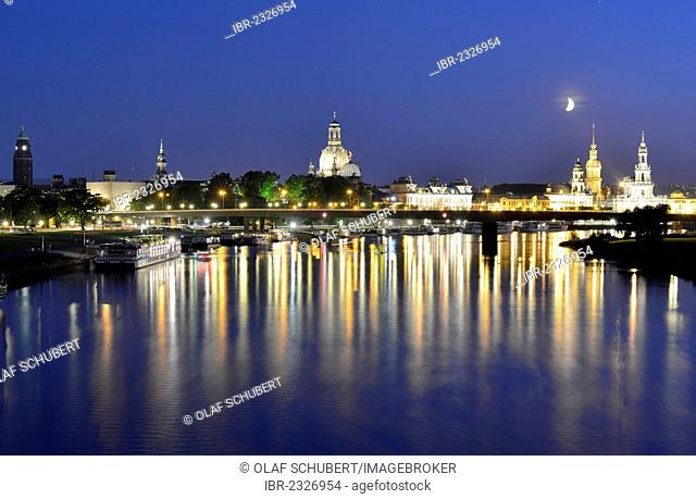 Florence on the Elbe at night, crescent moon above the Elbe river with the illuminated city skyline with Frauenkirche, Church of Our Lady