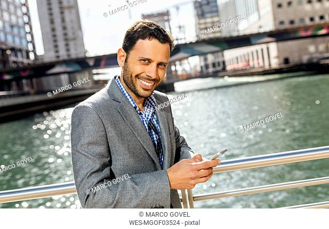 Portrait of a smiling businessman in the city