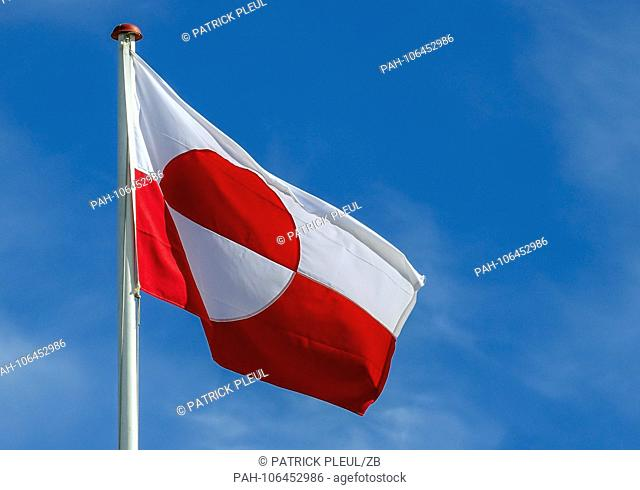 20.06.2018, Gronland, Denmark: The flag of Gronland, taken in the coastal town of Ilulissat in western Greenland. The city is located on the Ilulissat Icefjord