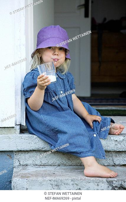 Girl drinking milk, Sweden